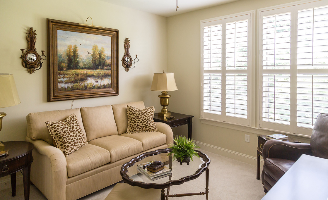 Louvered shutters featuring wooden slats in elegant living room