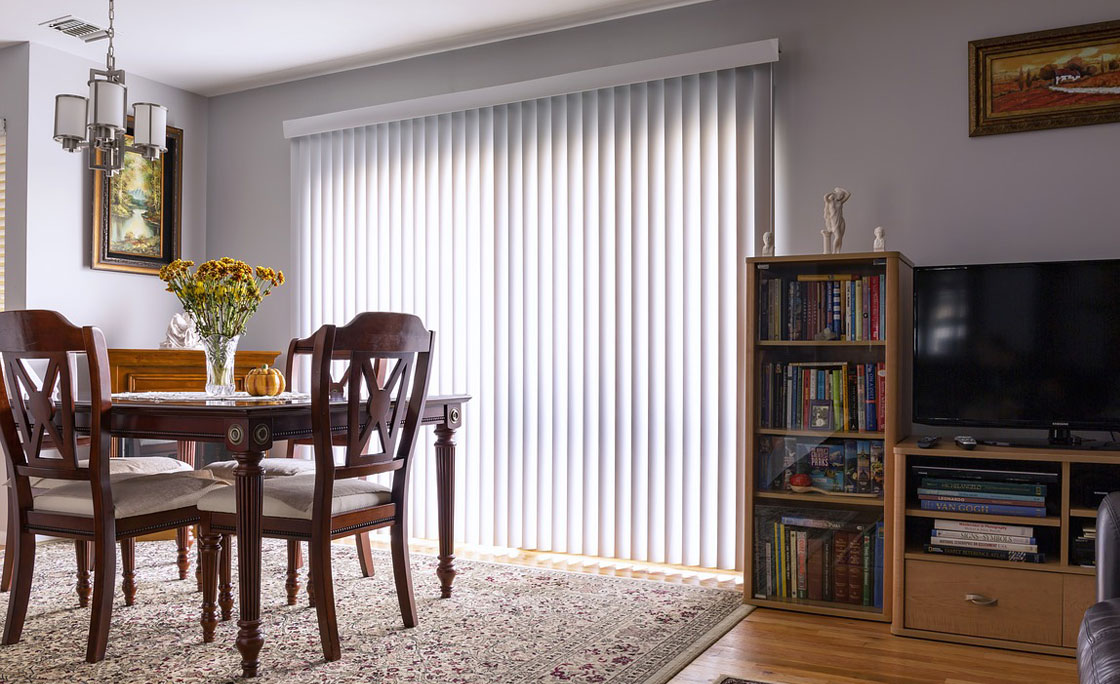 Vertical blinds allowing only partial light into stylish living room