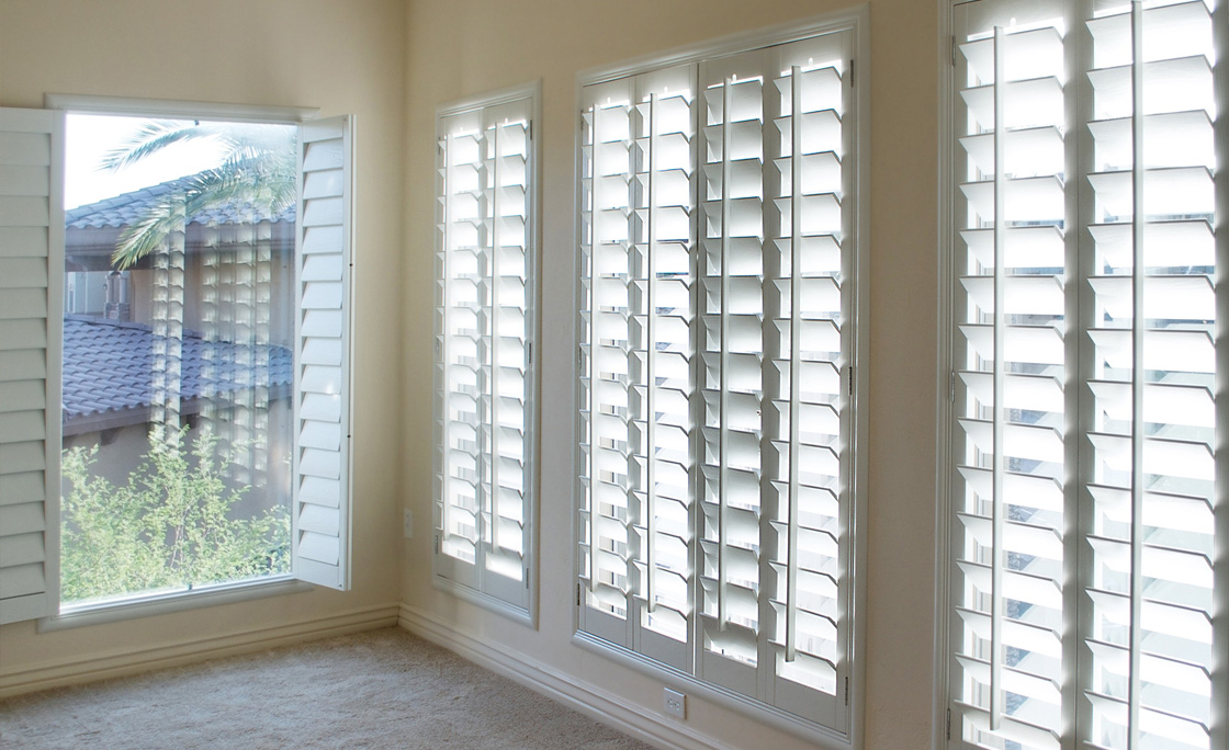 Long row of plantation shutters used across wide window space