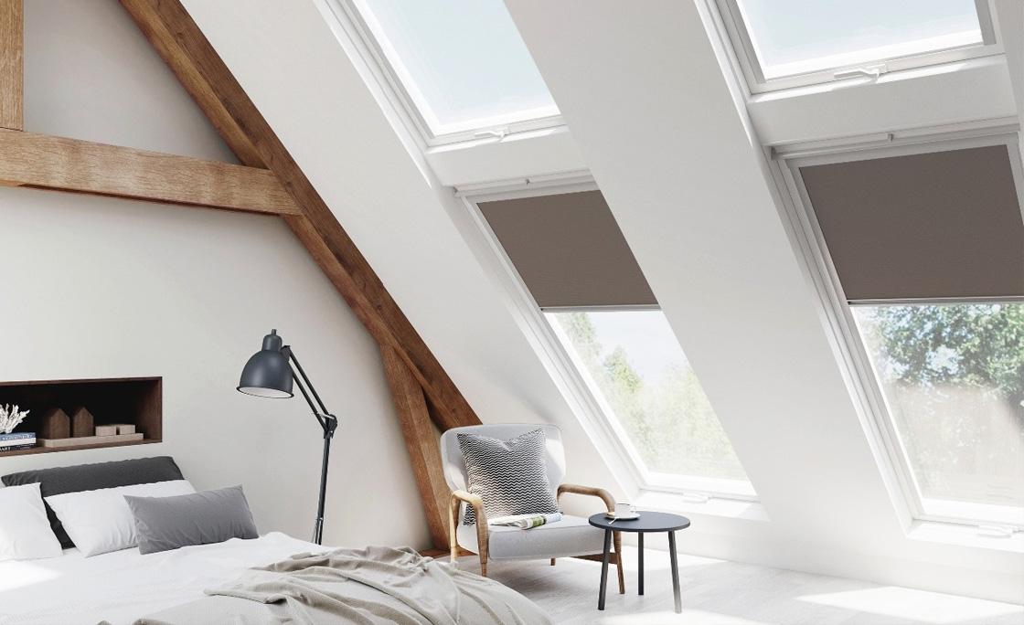 Modern loft bedroom using Velux windows and blinds